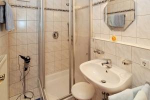 Badezimmer im Deluxe-Appartement**** mit Balkon